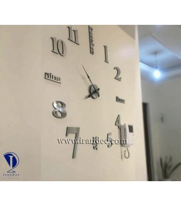 نمونه نصب شده ساعت دیواری مدرن کد 299 رنگ نقره ای با عقربه کلاسیک